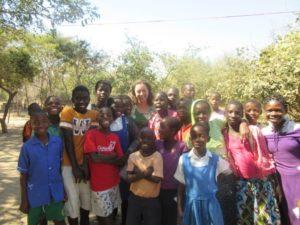 Volunteer pic - Kate with MOET children